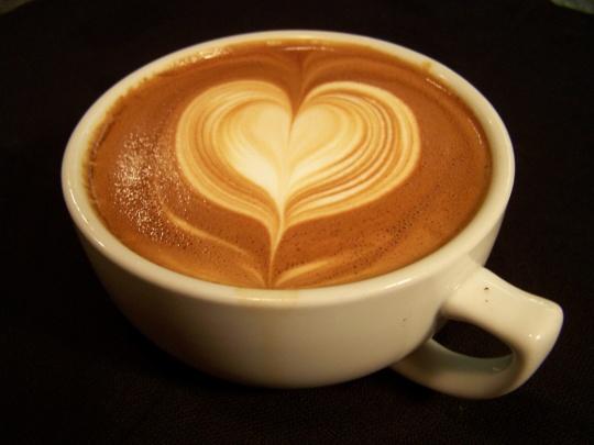 This is a heart design in a cappuccion latte